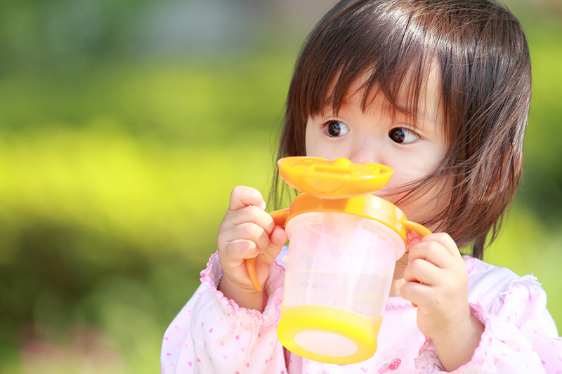 Little girl with sippy cup
