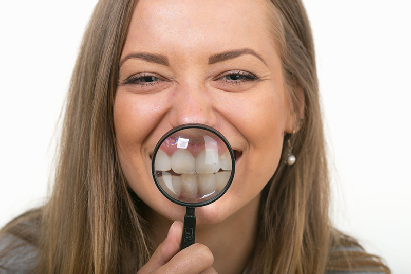 Woman magnifying her teeth