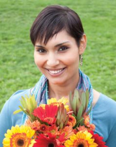 Woman smiling holding flowers