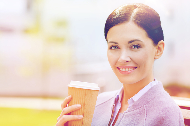 woman sipping sugary drink latte